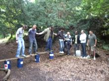 Offsite team building training - river crossing (dry) using planks and barrels